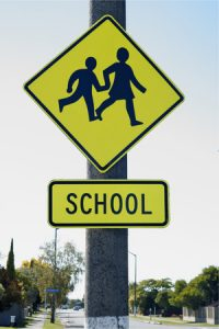 27584207 - school crossing sign warning drivers they are entering a school zone